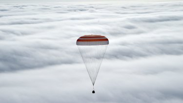 Russia's Soyuz TMA-18M space capsule carrying the International Space Station (ISS) crew of US astronaut Scott Kelly and Russian cosmonauts Mikhail Kornienko and Sergey Volkov prepares to land in a remote area outside the town of Dzhezkazgan, Kazakhstan.