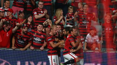 Striking out: Mitch Nichols celebrates with his team after scoring during the round nine A-League match between the Western Sydney Wanderers and the Brisbane Roar at Pirtek Stadium.