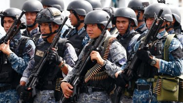 An armed unit of the Philippine Coast Guard are welcomed back in Manila.