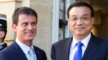 'China's carbon dioxide emissions will peak by around 2030' ... Chinese Premier Premier Li Keqiang, right, stands with French Prime Minister Manuel Valls in Paris.