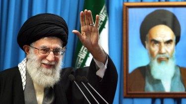 Iran's Supreme Leader, Ayatollah Ali Khamenei, delivers a sermon in 2012 beside a portrait of Ayatollah Ruhollah Khomeini, the figurehead of the Iranian Revolution.