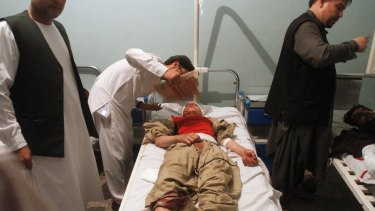 Relatives assist a wounded man in a hospital after a suicide attack on a mosque in Herat, Afghanistan on Tuesday.