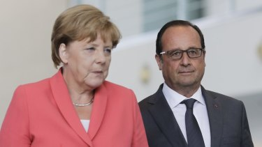 German Chancellor Angela Merkel and French President Francois Hollande on Monday: combining to elevate Europe's migrant crisis to top priority.