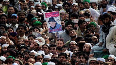 Protesters with a photo of police officer Mumtaz Qadri at his funeral in Rawalpindi, Pakistan, last week.