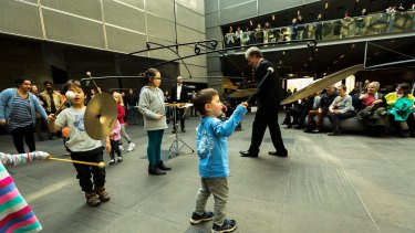Children interact with Mexican artist Carlos Amorales' installation in the foyer of NGV International.