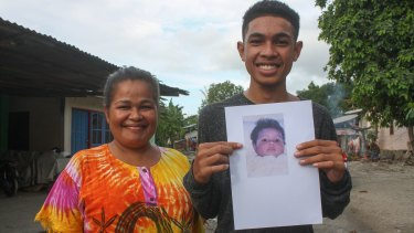 Pedro Unamet Remejio, right, was born in 1999 during the height of independence violence. Pictured here with his mum and holding a picture of himself as a baby.