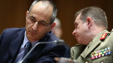 Michael Pezzullo, Secretary of the Department of Immigration and Border Protection, and Major-General Andrew Bottrell, Commander of Operation Sovereign Borders Joint Task Force, appear before the Legal and Constitutional Affairs References Committee.