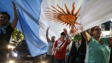 Supporters of opposition presidential candidate Mauricio Macri celebrate at the Plaza de La Republica in Buenos Aires, Argentina on Sunday.