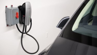 A car charging station is seen at the new Tesla showroom in New York.