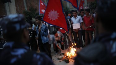 Students affiliated with Communist Party of Nepal near the Indian Embassy during a protest against the blockade of cargo trucks on Sunday.