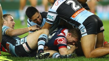 Defensive lapse: Cronulla concede at try to Mitch Aubusson during the win over the Roosters.