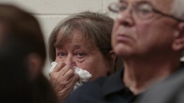 The grandmother of Conrad Roy III weeps as she listens to the defence attorney arguing for the involuntary manslaughter charge to be dismissed.