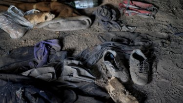 Discarded clothes, shoes and bread at an abandoned brick factory in Subotica, Serbia.