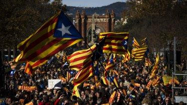"Pro independence demonstrators wave ""esteladas"" or pro independence flags, during a demonstrations to show public support for the Parliament of Catalonia, in Barcelona."