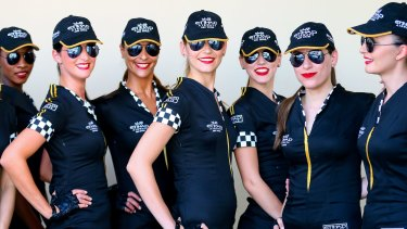 Grid Girls pose prior to the qualifying session at the Yas Marina Circuit in Abu Dhabi, United Arab Emirates, 02 November 2013.