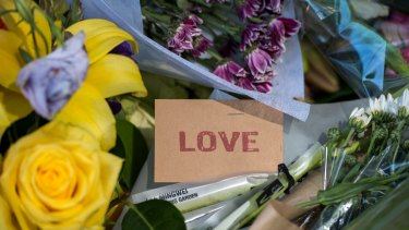 Tributes left outside the RACV club in Bourke Street for victims of the rampage.