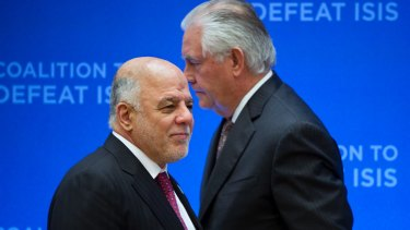 US Secretary of State Rex Tillerson, right, passes behind Iraqi Prime Minister Haider al-Abadi as he prepares to address the Meeting of the Ministers of the Global Coalition on the Defeat of ISIS, last week.