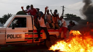 Protesters on a police vehicle at the protest against Burundi President Pierre Nkurunziza and his bid for a third term.