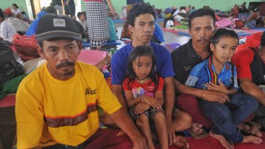 Kadek Nadi, centre, and his family have evacuated from Mount Agung.