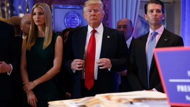 President-elect Donald Trump, accompanied by family members, waits to be introduced for the news conference.