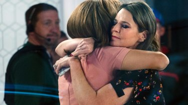 """Co-anchors Hoda Kotb and Savannah Guthrie embrace on the set of the """"Today"""" show after announcing Lauer's departure to viewers."""