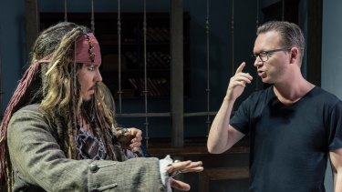 Johnny Depp as Captain Jack Sparrow with director Espen Sandberg on the set of Pirates of the Caribbean: Dead Men Tell No Tales.