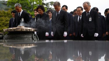 South Korea's new President Moon Jae-In, centre, pays silent tribute at the National Cemetery in Seoul on Wednesday.
