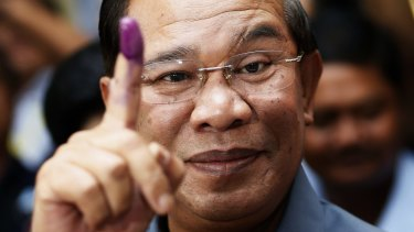 Ink print: Prime minister Hun Sen, once in the Khmer Rouge, photographed voting in 2013.