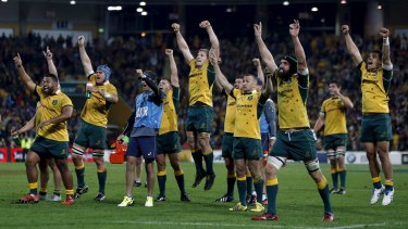 You beauty: The Wallabies celebrate as they watch a replay confirming Tevita Kuridrani had scored a controversial try at the end of their Rugby Championship match against South Africa's Springboks in Brisbane.