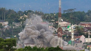 An explosion near a mosque as Philippine Air Force fighter jets bomb suspected locations of militants  in Marawi city.