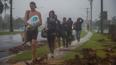 Backpackers from England, Germany and Finland leave the Bowen cyclone evacuation centre.