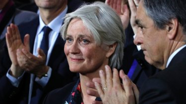 Penelope Fillon, wife of conservative presidential candidate Francois Fillon, right, reacts during a campaign meeting in Paris, on Sunday.