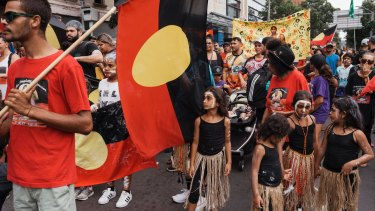Marchers gather for the Invasion Day rally at The Block in Redfern on Friday.