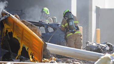 Emergency services personnel work at the  crash scene.