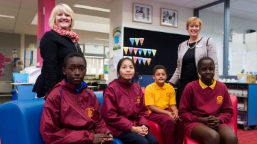 St Anthony's Primary Students (L-R) Emanuel, 11, Anna, 12, and Dandenong West Primary students Zavier, 11, and Adau, 11 with St Anthony's principal Marg Batt (L) and Dandenong West principal Bev Hansen.  The two schools are collaborating on a range of academic programs.  Photo Paul Jeffers The Age NEWS 14 May 2015
