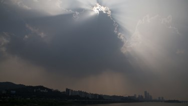 Under threat: The city skyline stands shrouded in haze in Seoul, South Korea.