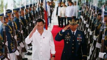 Philippines President Rodrigo Duterte (left)  salutes the honour guard prior to his departure for Cambodia and Singapore.
