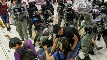 Riot police and protesters clash in a Hong Kong shopping mall at the weekend.