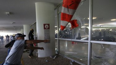 Police officers attempt to break into the Brazilian National Congress during a protest by officers from several Brazilian states against pension reforms.