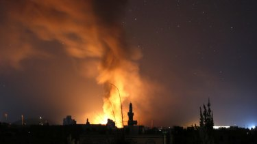 Fire and smoke rise after a Saudi-led airstrike in Sanaa, Yemen on September 17.