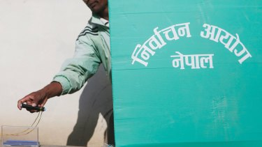 A Nepalese man casts his vote  on Sunday.