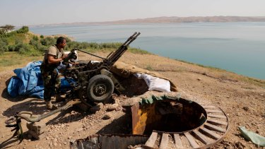 A Kurdish peshmerga outside Mosul, Iraq, in 2014.