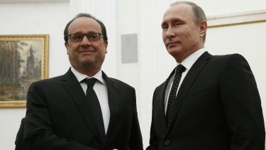 'Our enemy is Islamic State': French President Francois Hollande meets Russian President Vladimir Putin in Moscow on Thursday.