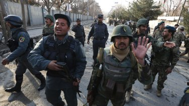 Security forces inspect the site of the attack in Kabul.