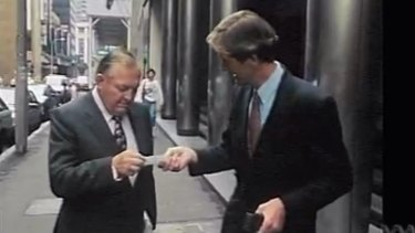 The ABC's Paul Barry confronts Alan Bond in an incident that infamously led to Bond stomping on Barry's business card.