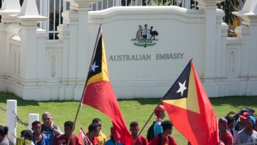 Protesters assembled outside the gates of the Australian embassy in Dili in February, demanding negotiations over the Timor Sea boundary.