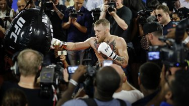 All eyes: Conor McGregor trains during a media workout.