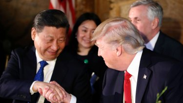 Donald Trump and Xi Jinping shake hands during a dinner at Mar-a-Lago.