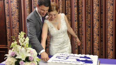 Australian Ruth Greenwood and her husband Nick cut their wedding cake in the shape of the electoral map of Winsconsin.