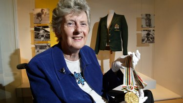 Betty Cuthbert with her 1964 gold medal and blazer at the Powerhouse Museum where memorabilia from her career were part of an exhibition in 2003.